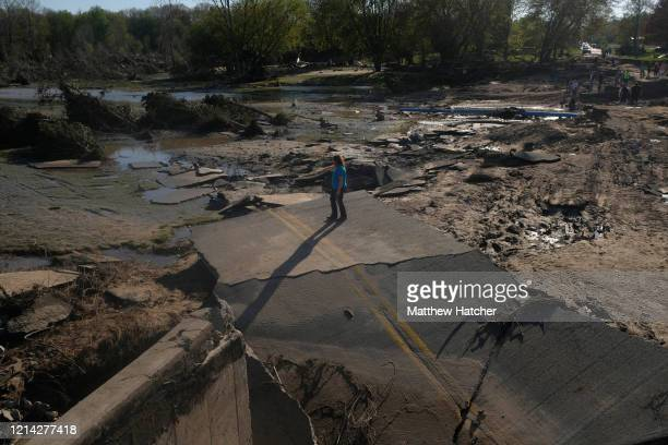 Residents explore what remains of the West Curtis Road bridge which was swept away following extreme flooding throughout central Michigan on May 20,...