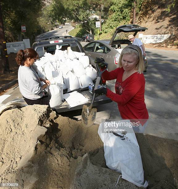 Residents fill sand bags to prepare in advance of the first rain storm since before the massive Station fire began for the possible major mudslides...