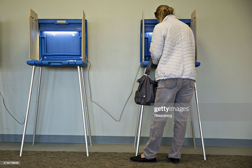 A residents fills out a ballot at a polling location during the presidential primary vote in Waukesha, Wisconsin, U.S., on Tuesday, April 5, 2016. Wisconsin voters went to the polls Tuesday to decide whether Donald Trump's latest self-inflicted wounds are deep enough to deny him a win in the state's Republican primary, and, in turn, to diminish his hopes of winning the presidential nomination. Photographer: Daniel Acker/Bloomberg via Getty Images
