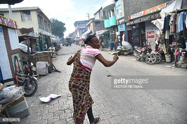 Residents flee of the tear gas fired by Haitian police as supporters of presidential candidate Maryse Narcisse of Lavalas march to claim the victory...