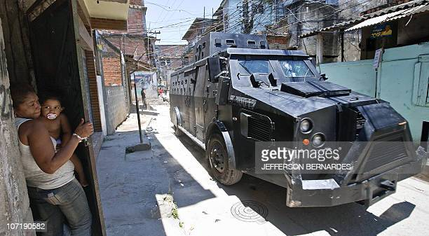 Residents flee the conflict area during the raid in the Morro do Alemao shantytown on November 28 2010 in Rio de Janeiro Brazil After days of...