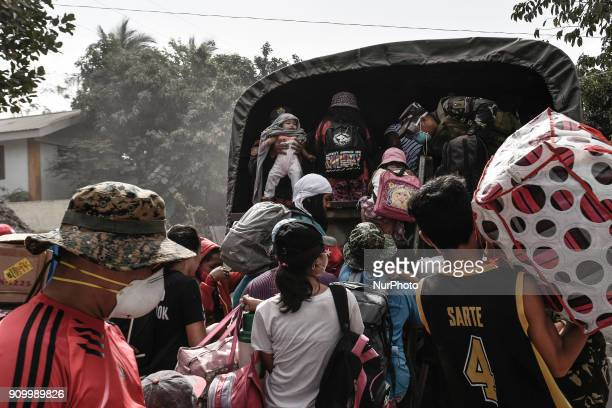 Residents flock to board a military truck as they flee the nine kilometer extended danger zone around Mount Mayon in Guinobatan Albay province...