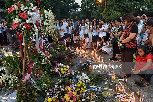 Residents flock to offer flowers, candles, and prayers on ground zero of the blast site that recently killed more than a dozen people in Davao city,...