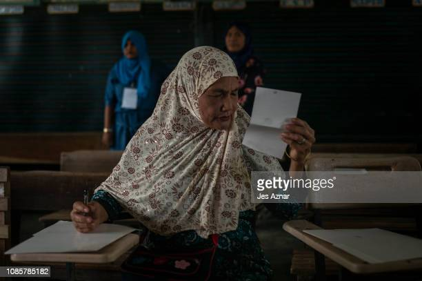 Residents flock to polling precincts to cast their votes on January 21 2019 in Cotabato City southern Philippines Nearly three million Filipinos in...