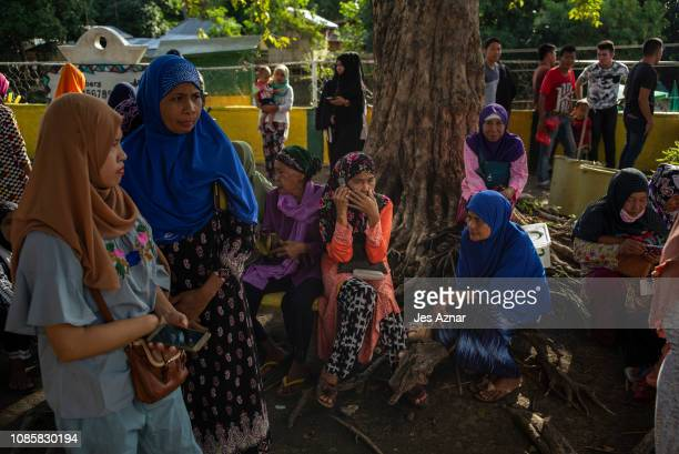 Residents flock to polling precincts to cast their votes on January 21 2019 in Bugawas Maguindanao southern Philippines Nearly three million...