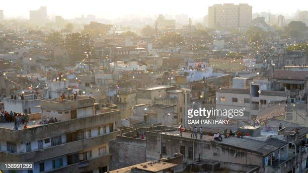 Residents fly kites from rooftops in the Walled City of Dariyapur area of Ahmedabad during Makar Sankranti on January 14 2012 The festival concludes...