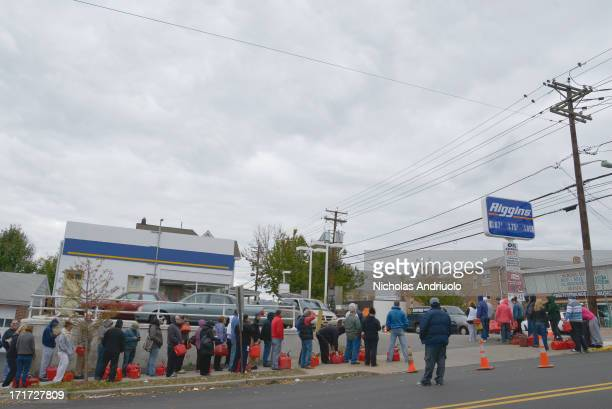 CONTENT] Residents form an orderly line for blocks waiting to fill up their red gas tanks Many stations were closed due to power outages from...