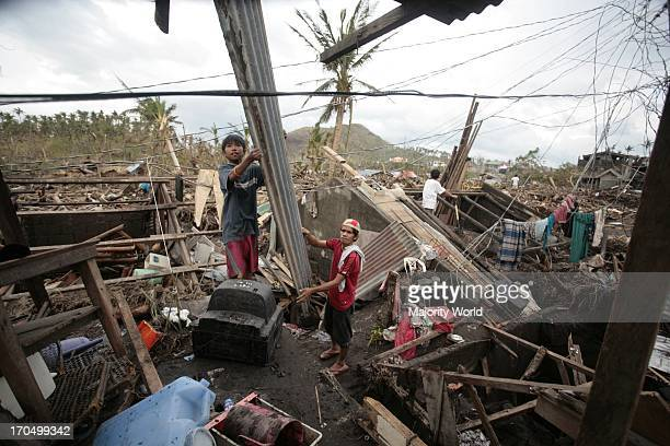 Residents from Binitayan Daraga Albay in the Bicol region salvage whatever is left of their houses The Bicol Region was hit by super typhoon Durian...