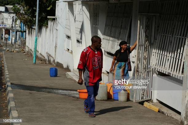Residents from the Comoros Island Anjouan main city Mutsamudu recover water after it was cut on October 19 2018 in Anjouan Comoros Comoros security...