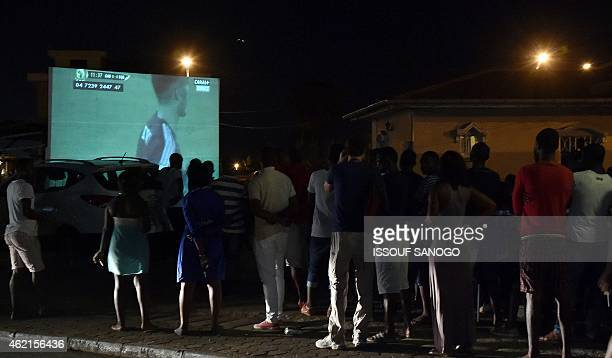 Residents gather in Malabo to watch the 2015 African Cup of Nations group A football match between Equatorial Guinea and Gabon taking in place in...