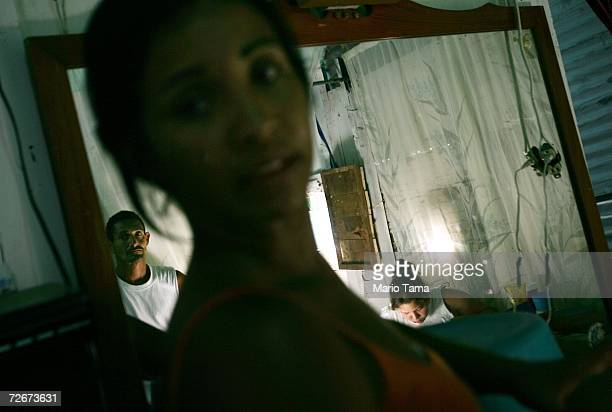 Residents gather in the poor barrio of Coche November 29 2006 in Caracas Venezuela Despite daily problems with fresh water and electricity residents...