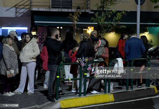 Residents gather outdoors in Tirana after two earthquakes above 6.3 magnitude struck the Adriatic coastline of Albania on November 26, 2019. - A...