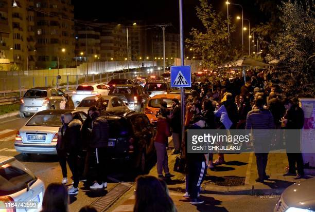 Residents gather outdoors in Tirana after two earthquakes above 63 magnitude struck the Adriatic coastline of Albania on November 26 2019 A powerful...