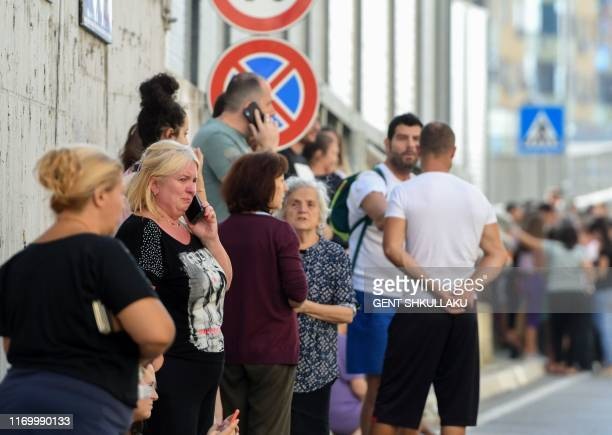 Residents gather outdoors in Tirana on September 21 after two earthquakes above 5.0 magnitude struck the coastline Adriatic coastline of Albania.