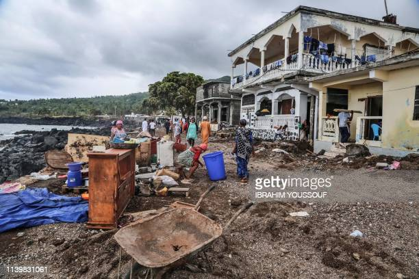 Residents gather their belongings on April 27, 2019 in Fumbuni, 56km south of Comoros capital Moroni, following the passage of the Cyclone Kenneth. -...