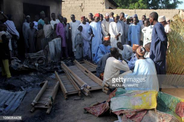Residents gather to mourn and bury the deads following multiple attacks by Boko Haram Islamists at Dalori and other neighbouring villages outside the...