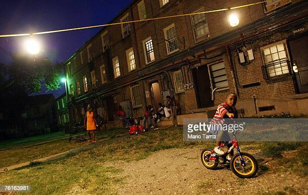 Residents gather under lights they put up themselves in the B.W. Cooper housing project August 17, 2007 in New Orleans, Louisiana. Before Hurricane...
