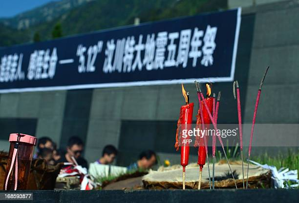 Residents give offerings before the monument of the 5/12 Sichuan earthquake on the 5th anniversary of the disaster on May 12 in Yingxiu township of...