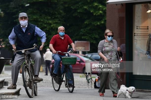 Residents go about their activities on May 20, 2020 in Codogno, southeast of Milan, one of the villages at the epicenter of the coronavirus epidemic...