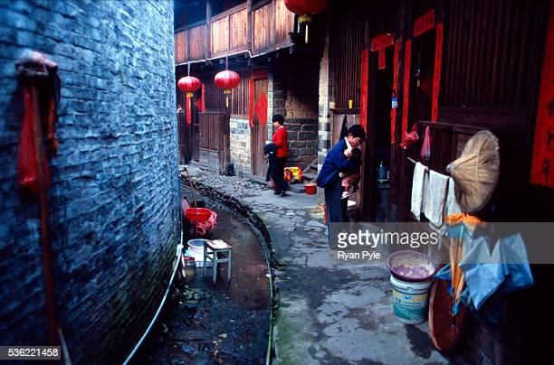 Residents go about their daily lives inside a traditional Hakka Tulou home in the county of Yongding, well known as the Hakka Tulou region, in...