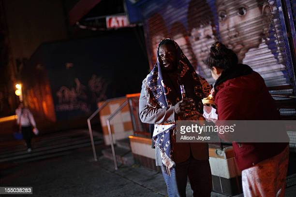 Residents have a party on the sidewalk during a power outage following Hurricane Sandy October 30 2012 in New York City The storm has claimed at...
