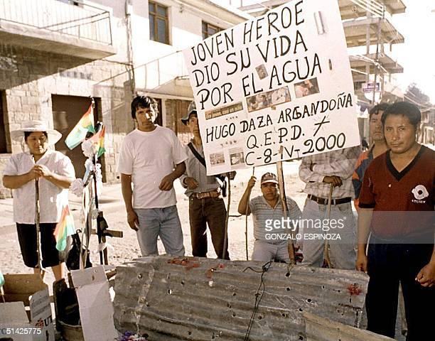 Residents hold a vigil, 10 April 2000 in Cochabamba, to protest against water regulations in the city. Residentes mantienen una vigilia, el 10 de...