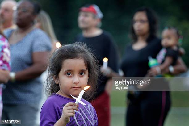 Residents hold candles during a vigil for Alison Parker on Martinsville High School's football field on August 27, 2015 in Martinsville, Virginia....