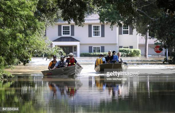 Residents in a neighborhood near the Barker Reservoir return to their homes to collect belongings August 31, 2017 in Houston, Texas. The...