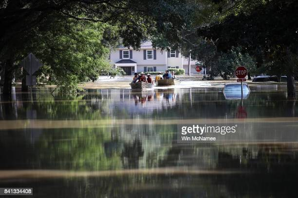 Residents in a neighborhood near the Barker Reservoir return to their homes to collect belongings August 31 2017 in Houston Texas The neighborhoods...