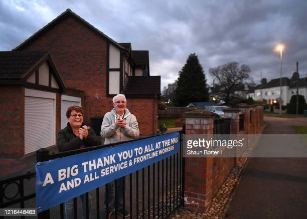 Residents in Abington Vale applaud NHS staff and other key workers from their home on April 02 2020 in Northampton United Kingdom Members of the...