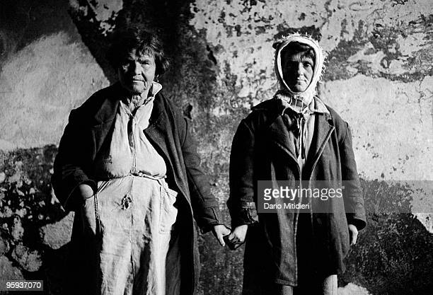 Residents in an abandoned mental institution in central Albania wait for help following the fall of the Communist regime in 1991 During this period...