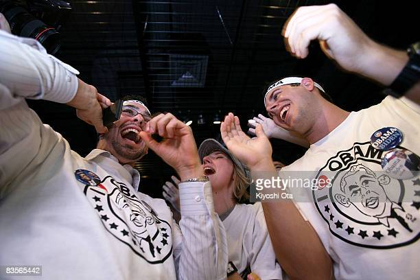 S residents in Japan celebrate as they see the lead of the Democratic presidential candidate US Sen Barack Obama in the US presidential election...