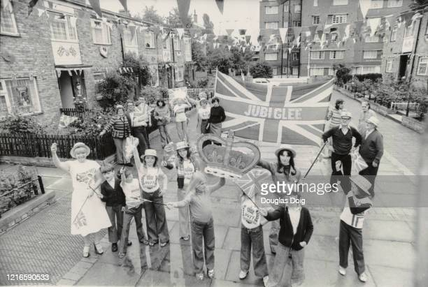 Residents in St Matthews Road Brixton after they won a competition for the best decorated street to celebrate the Silver Jubilee of Queen Elizabeth...