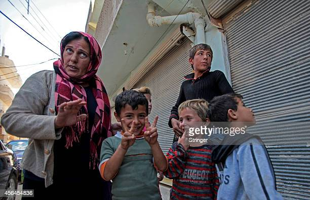 Residents in the besieged Kurdish city of Ain al-Arab , September 30, 2014 in Kobane, Syria. Islamic State militants still held their positions...
