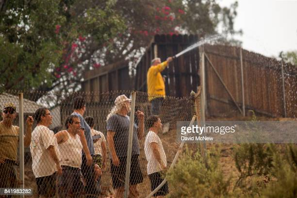 Residents in the community of Tujunga watch nearby growing flames during the La Tuna Fire on September 2 2017 near Burbank California Los Angeles...