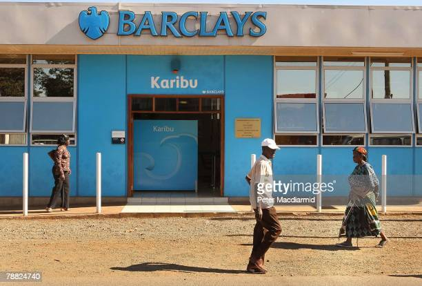 Residents in the Kawangware slum walk past a branch of Barclay's Bank on January 8 2008 in Nairobi Kenya Normal business has resumed in the capital...