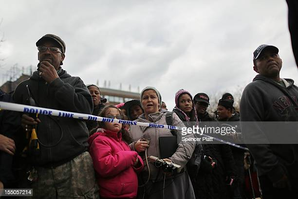 Residents in the Rockaway section of Queens wait to charge their phones at a government generator on October 31, 2012 in the Queens borough of New...
