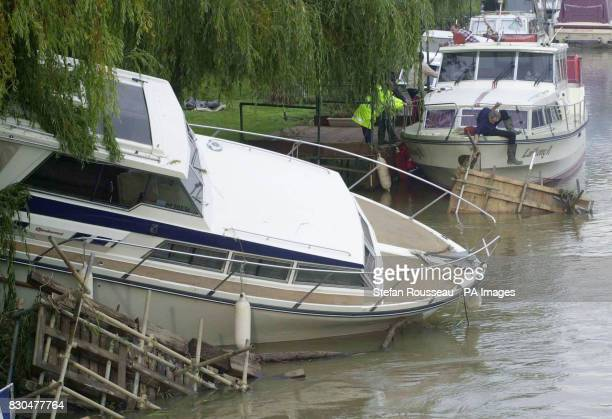 Residents in Wateringbury Kent survey the damage to their boats after the River Medway burst its banks Five rivers in Kent were being kept on Severe...