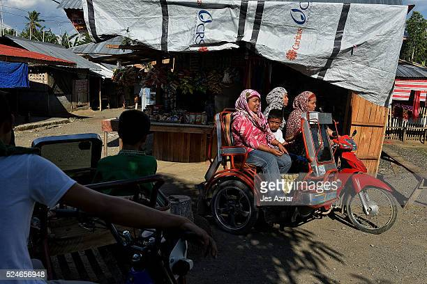 Residents inside the Moro Islamic Liberation Front camp Darapanan in Maguindao on April 15 2016 in Maguindanao Province Philippines For more than...