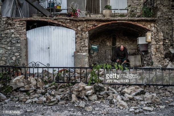 TOPSHOT Residents inspect the damage and fallen masonry in the Rouviere quarter of Le Teil southeastern France on November 12 after an earthquake...
