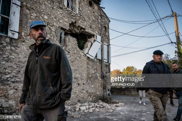 Residents inspect the damage and fallen masonry in the Rouviere quarter of Le Teil southeastern France on November 12 after an earthquake with a...