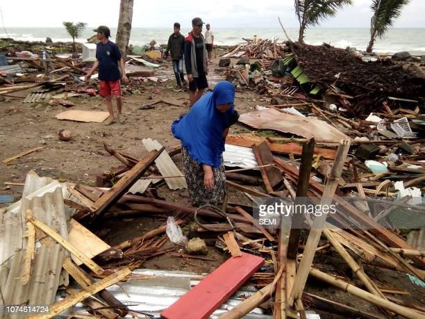 Residents inspect the damage to their homes on Carita beach on December 23 after the area was hit by a tsunami on December 22 that may have been...