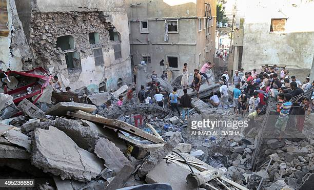 Residents inspect the debris of a building that collapsed during a reported Saudi-led coalition air strike against Shiite Huthi rebels and their...