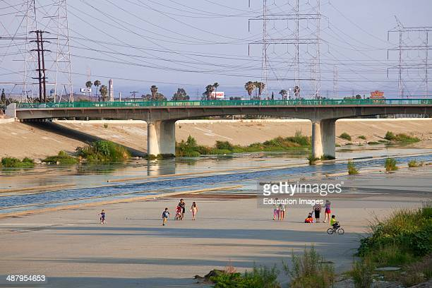 Residents keeping cool on a hot Summer evening by walking along the Los Angeles River Bell Los Angeles County California