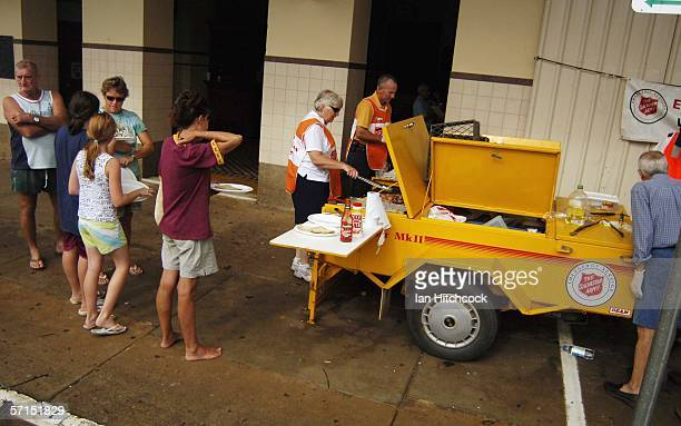 Residents line up for breakfast supplied by the Salvation Army March 22 2006 in Innisfail Australia Tropical Cyclone Larry crossed the coast as a...