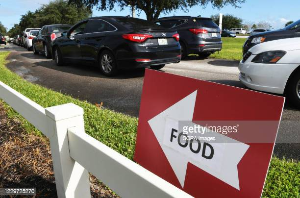 Residents line up in their cars at a food distribution site at Lake-Sumter State College sponsored by the Second Harvest Food Bank of Central Florida...