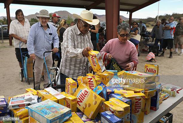 Residents line up to receive free food at mobile food pantry near the USMexico border on September 26 2016 in Jacamba Hot Springs California The...