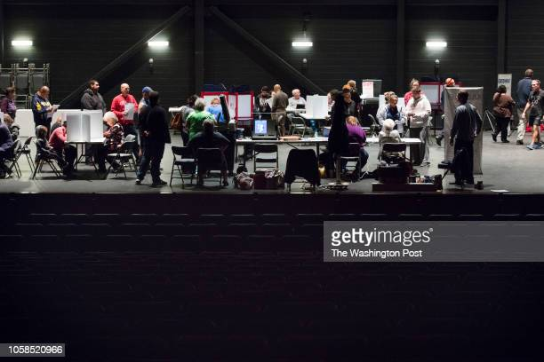 RICHMOND KENTUCKY USA NOVEMBER 6 2018 Residents line up to vote on the stage at the Eastern Kentucky University's Center for the Arts in Richmond Ky...