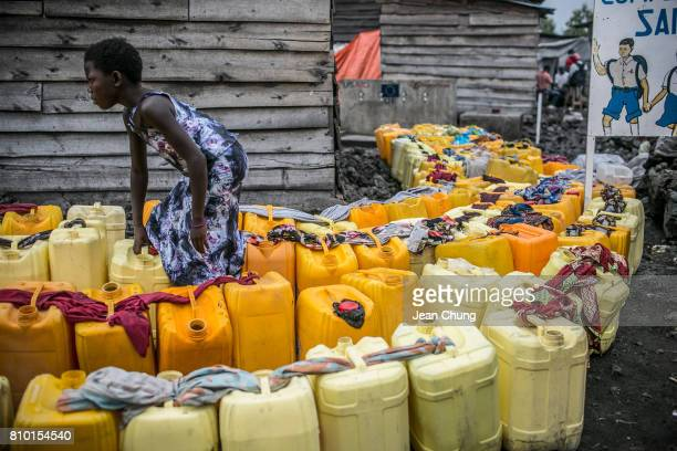 Residents lined up their water containers to the water stand in Katoyi the outskirt of Goma on June 14 2014 in Goma Democratic Republic of Congo...