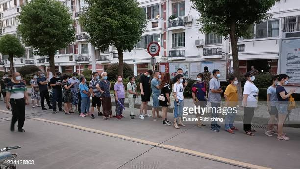 Residents lined up to apply for travel permits. On the evening of August 3 Jinhu County, Huai'an City, Jiangsu Province. Due to the impact of the...